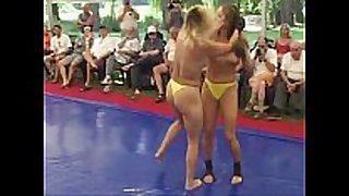 Topless women fight