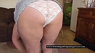 Mature granny in taut white pants