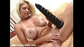 Busty blond milf riding a monster brutal sex toy