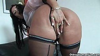 Sleazy mommys in corset and stockings having solo...