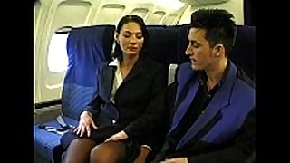 Brunette beauty wearing stewardess uniform acquires...