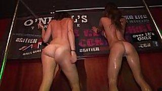 Drunken hot college beauties undress in nature's garb on stage...