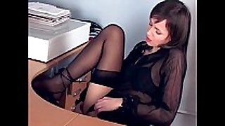 Brunette masturbates in sheer stockings and heels