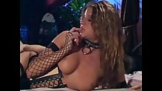Sex in a corset dark boots and fishnet stockings