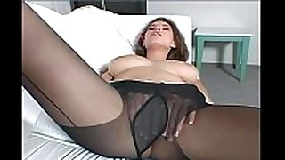 Busty black brown milf teases in black pantyhose