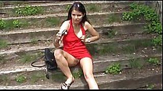 Red dressed sexually sexually lascivious BBC doxy in a public park .