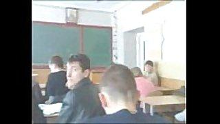 Schoolgirls have pleasure in classroom