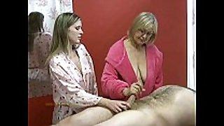 Senior masseuse helps junior masseuse in jerkin...