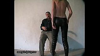 Girl in leather pants kick a fellow 01