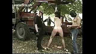 Naked serf with great body is spanked on her a...