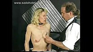 Skinny thrall is pulled on her nipples spanked a...
