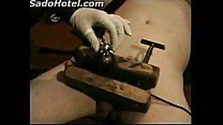 Dominatrix in latex dress electroshocks strapon of ...