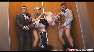 Slutty secretary serves two hard cocks in an elevator