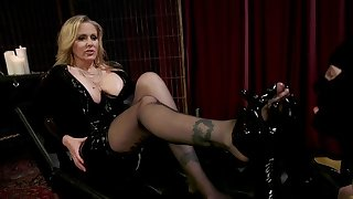 Dominant MILF with big juggs plays with her personal slave