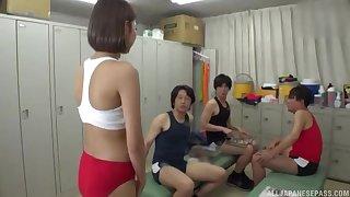 Asian cutie pleasuring three horny men in the locker room