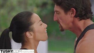 Pretty brunette with natural tits gets assfucked by her personal trainer